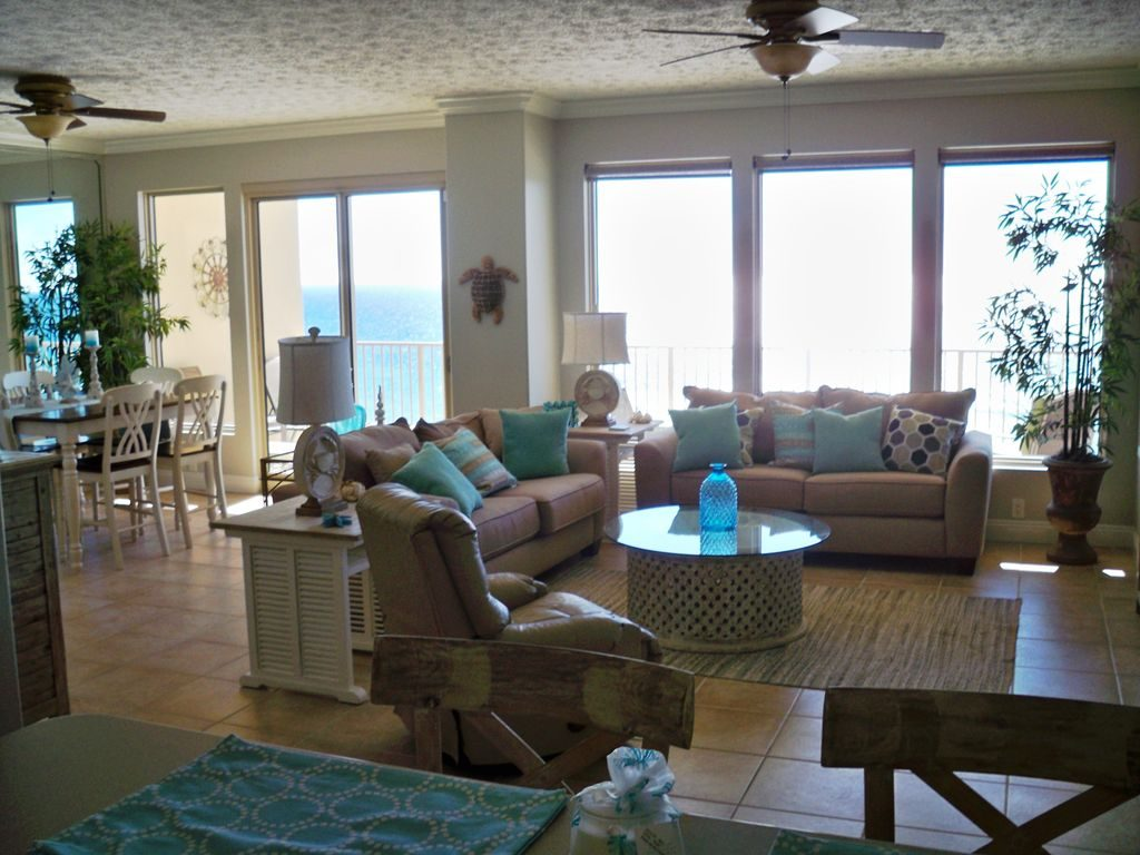 View of the living room, dining area, balcony, and beautiful view