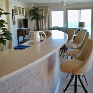 Unit 707 kitchen bar area off the living room with views of the Gulf of Mexico