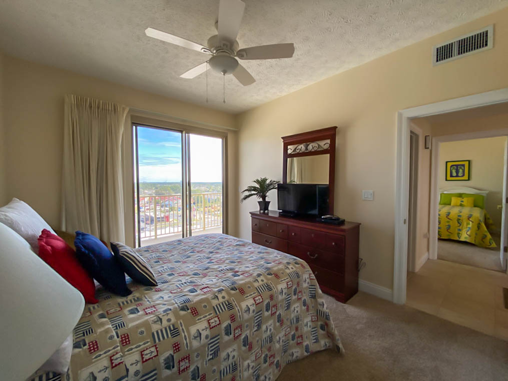 Bedroom with ceiling fan and view