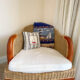 wicker chair with nautical pillows