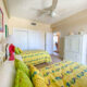 2 beds in brightly colored bedroom