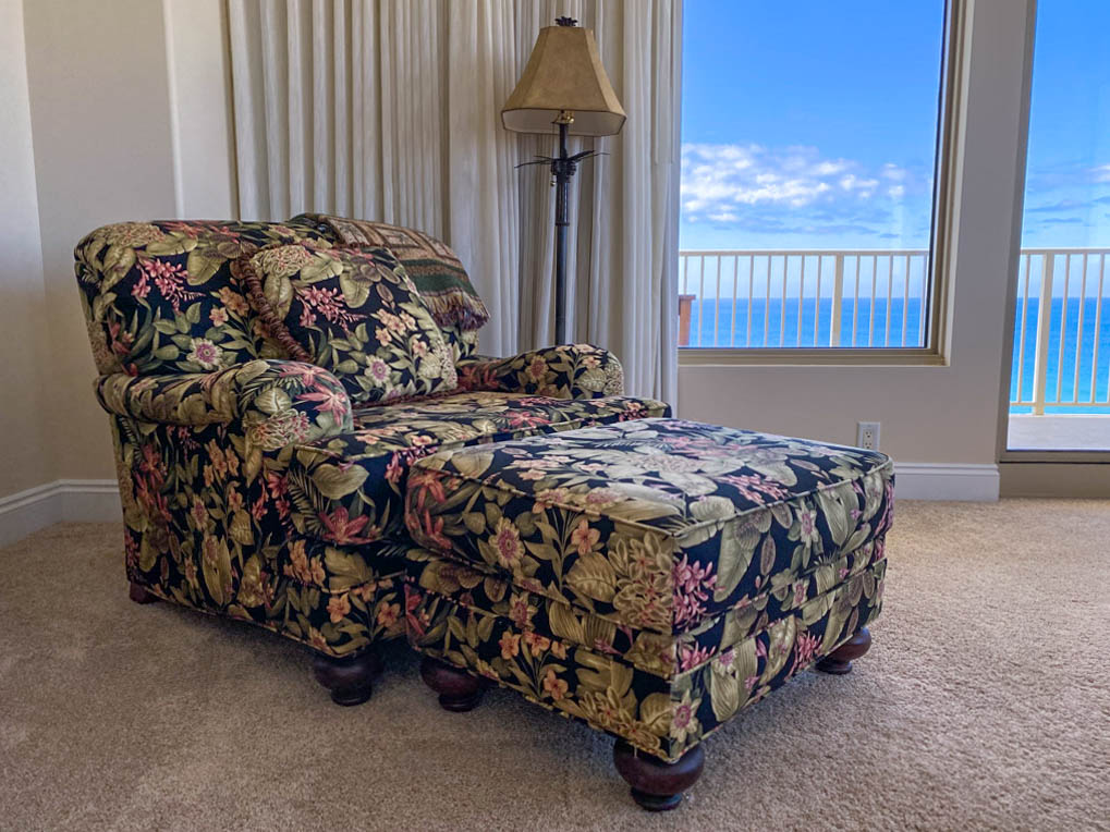comfy upholstered chair by window