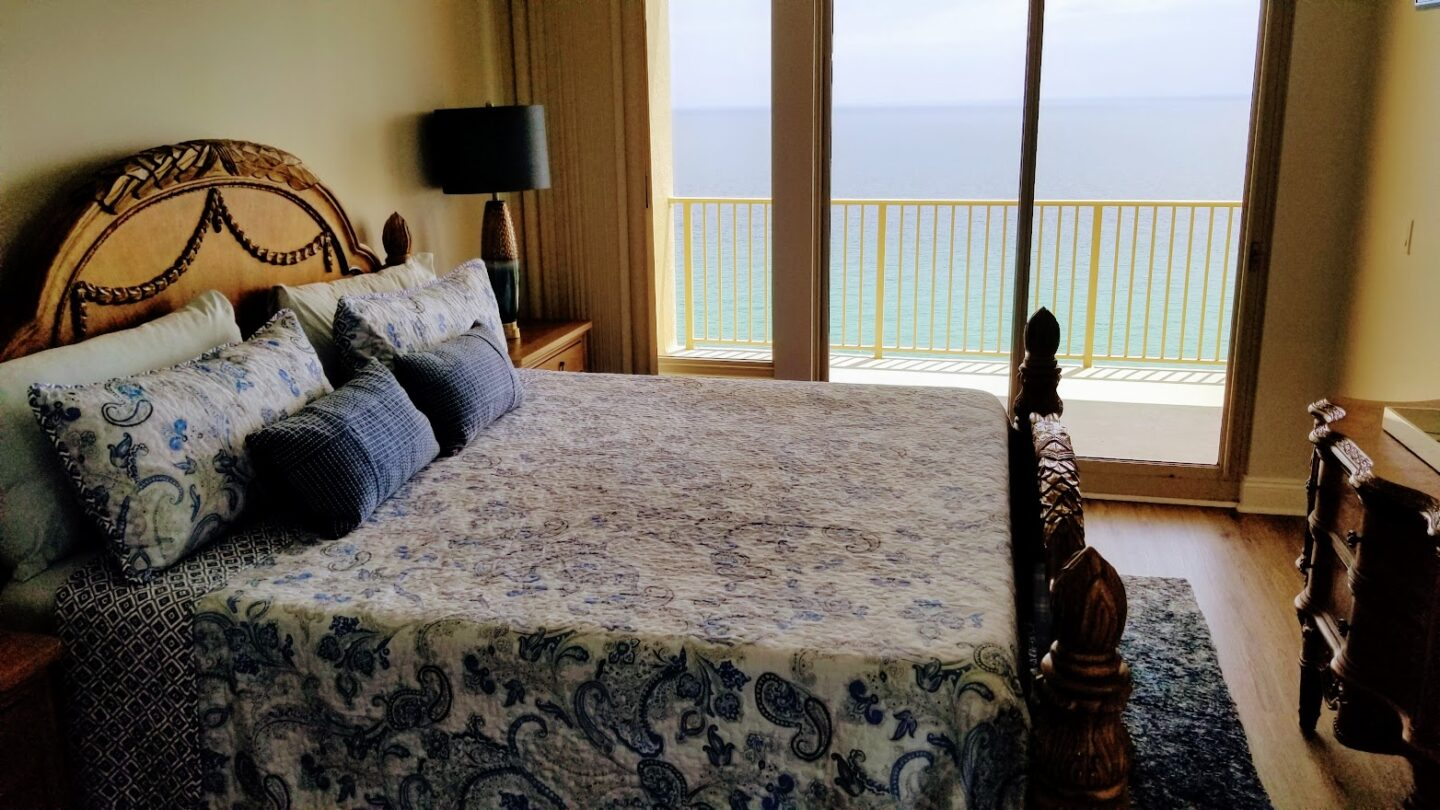 balcony off bedroom with beach and waterfront view