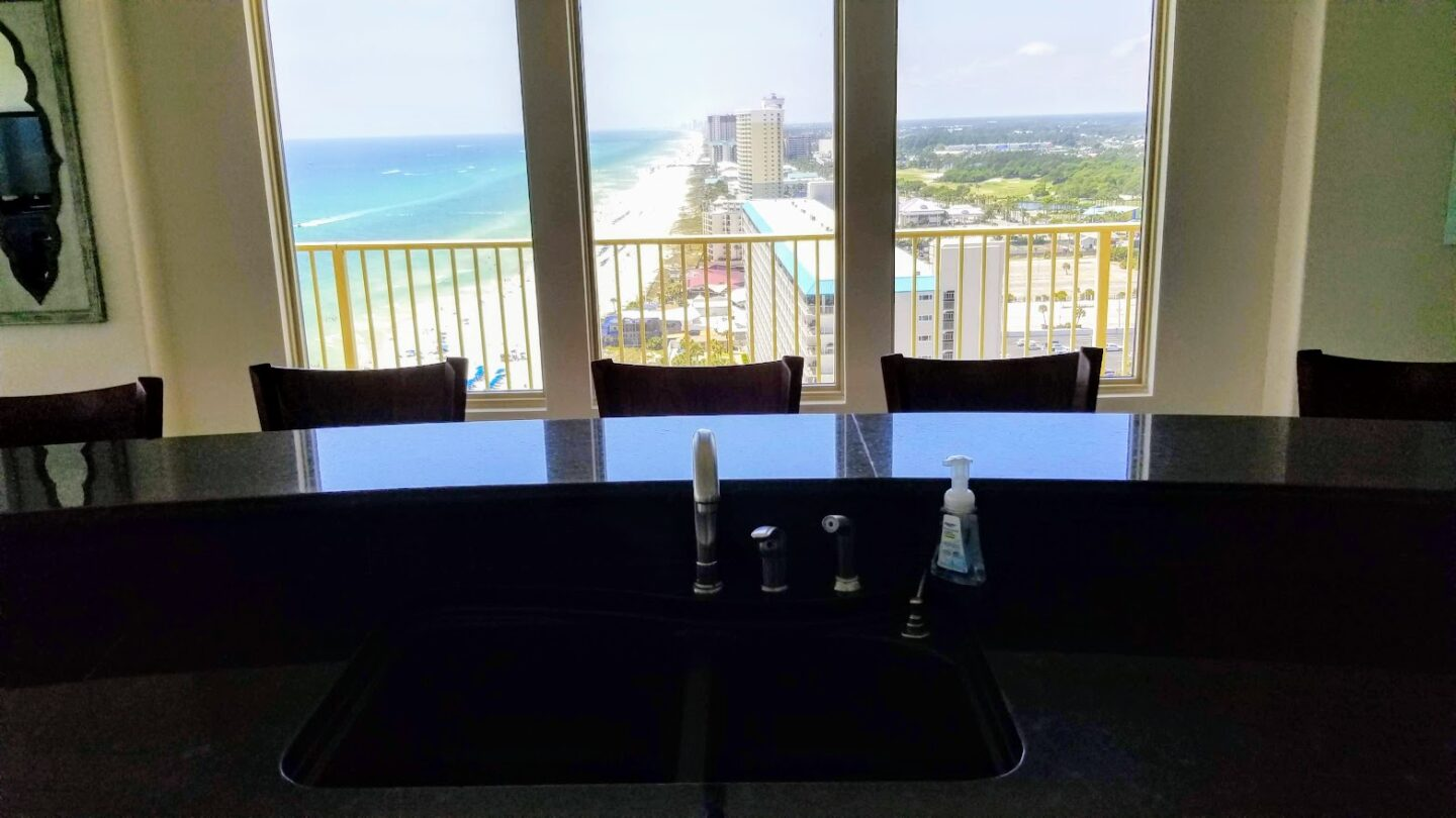 view of beach and water from kitchen